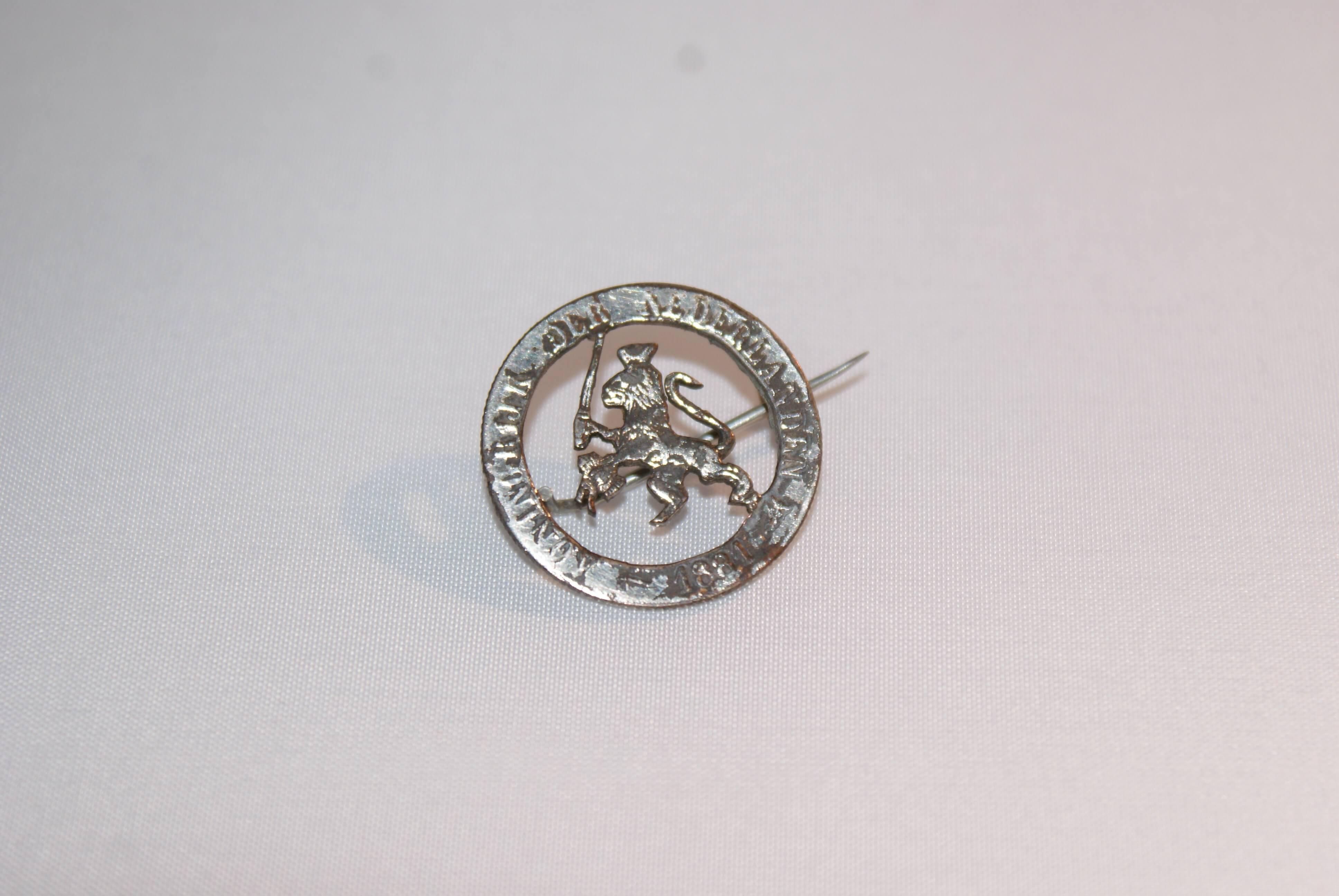 Broche van munt uit 1881
